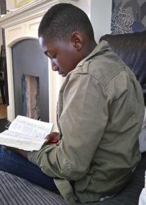 Boy doing Bible Study
